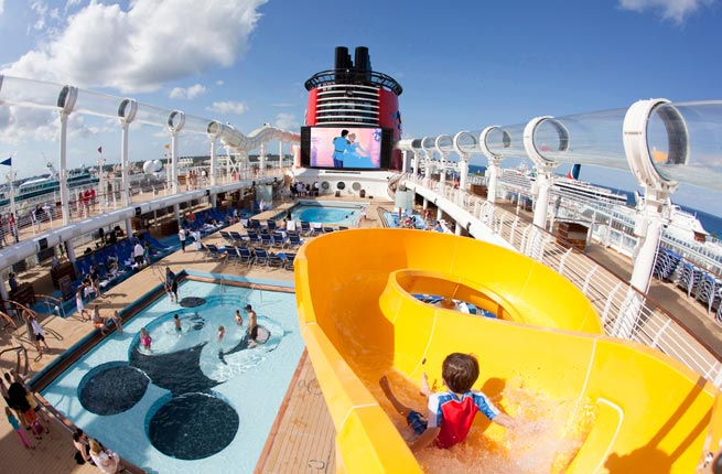 Mickey's Pool, a favorite feature of the Disney Cruise Line fleet, continues on the Disney Dream. This play area for children features a Mickey Mouse-shaped pool and an oversized version of Mickey's hand supporting a yellow winding slide that splashes down into the pool area. (Jimmy DeFlippo, photographer); MICKEY'S POOL ON THE DISNEY DREAM